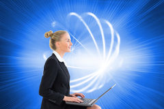 Businesswoman using laptop Royalty Free Stock Images