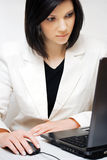 Businesswoman using laptop. Royalty Free Stock Photos