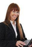 Businesswoman using a laptop. Happy and confident businesswoman using a laptop stock photos