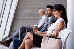 Businesswoman Using Laptop In Airport Departure Lounge Royalty Free Stock Photos