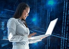 Businesswoman using laptop with binary codes in background Stock Images