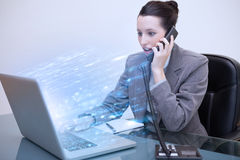 Businesswoman using laptop with blue lights exploding from her s Stock Photo