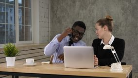 Businesswoman Using Laptop And Businessman Making Call Team work stock image