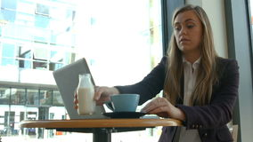 Businesswoman using laptop in cafe. In high quality format stock video