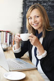 Businesswoman Using Laptop In Cafe Stock Image