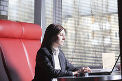 Businesswoman Using Laptop In Cafe Royalty Free Stock Images