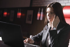 Businesswoman Using Laptop And Cellphone In Cafe Stock Photography