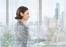 Businesswoman using laptop comouter Royalty Free Stock Image