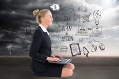 Businesswoman using laptop Stock Image