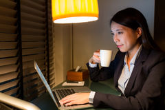 Businesswoman using laptop computer in office. Asian young woman portrait Royalty Free Stock Photography