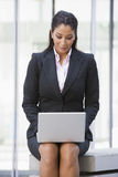 Businesswoman using laptop computer outside. Office Royalty Free Stock Photo
