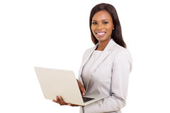 Businesswoman using laptop computer Stock Images