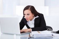 Businesswoman using laptop Royalty Free Stock Image