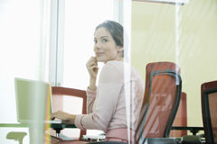Businesswoman Using Laptop In Conference Room Stock Photos