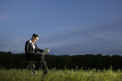 Businesswoman Using Laptop In Field Royalty Free Stock Image