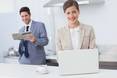 Businesswoman using a laptop while having breakfast Royalty Free Stock Photo