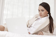 Businesswoman using laptop in hotel room Stock Photo