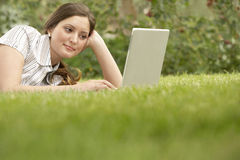 Businesswoman Using Laptop While Lying On Grass Stock Photos