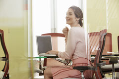 Businesswoman Using Laptop In Meeting Room Royalty Free Stock Image