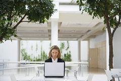 Businesswoman Using Laptop At Office Cafe Royalty Free Stock Photo