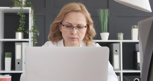 Businesswoman using laptop at office stock footage
