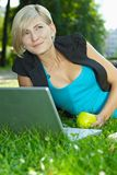 Businesswoman using laptop outdoor Stock Photo