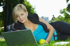 Businesswoman using laptop outdoor stock image