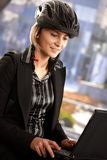 Businesswoman using laptop outdoor Stock Images