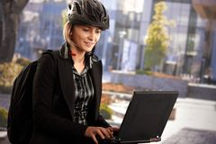 Businesswoman using laptop outdoor Stock Photo