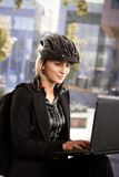 Businesswoman using laptop outdoor Stock Image