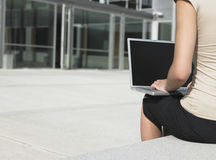 Businesswoman Using Laptop Outside Office Stock Photography
