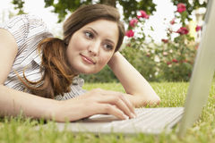 Businesswoman Using Laptop At Park Stock Images