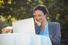 Businesswoman using laptop Royalty Free Stock Image