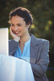 Businesswoman using laptop. In a restaurant Royalty Free Stock Image