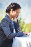 Businesswoman using laptop. In a restaurant Royalty Free Stock Photos