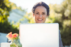 Businesswoman using laptop. In a restaurant Stock Photo