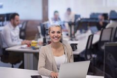 Businesswoman using a laptop in startup office Stock Photos