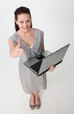 Businesswoman using a laptop with thumb up Stock Images