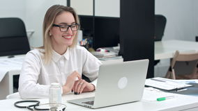 Businesswoman using laptop for video call stock footage