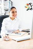 Businesswoman using laptop for work while sitting at the office Stock Photography