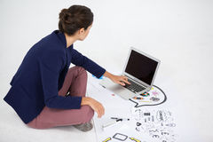Businesswoman using a laptop Stock Photo