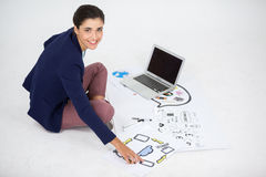 Businesswoman using a laptop. Businesswoman using laptop while working on icon charts against white background Stock Photos