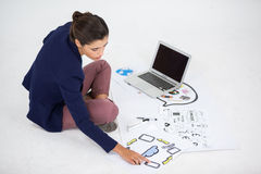 Businesswoman using a laptop Stock Images