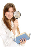 Businesswoman using magnifying glass Royalty Free Stock Images