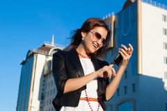 Businesswoman using media application in a phone Royalty Free Stock Image