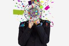 Businesswoman using megaphone emitting confetti against white background Stock Photos