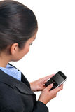 Businesswoman using a mobile device Royalty Free Stock Image