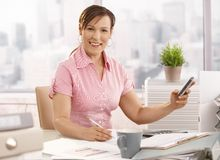 Businesswoman using mobile phone Stock Images