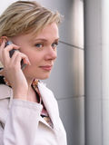 Businesswoman using a mobile phone Stock Photos