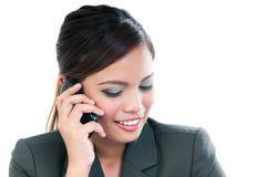 Businesswoman using mobile phone Stock Image